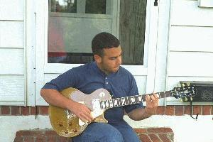 Danny playing his Les Paul gold top on his front steps